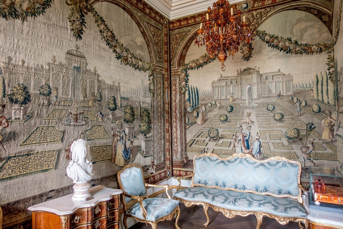 Room with tapestries and brocade furniture