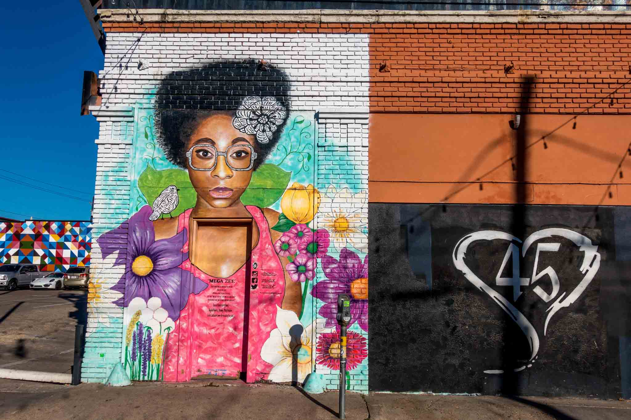 Street art showing a woman with bright flowers