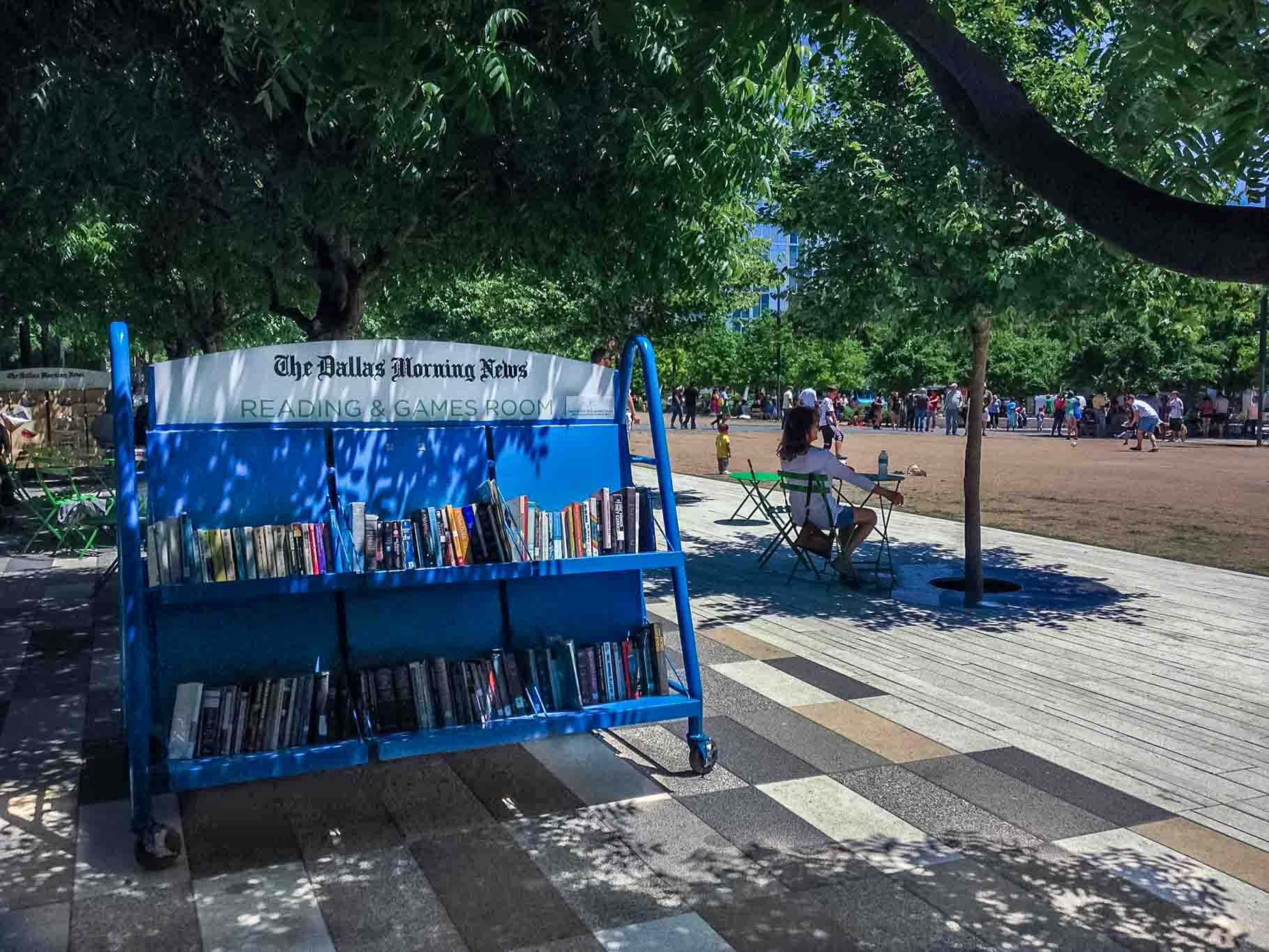 Reading area and books on shelf in a park