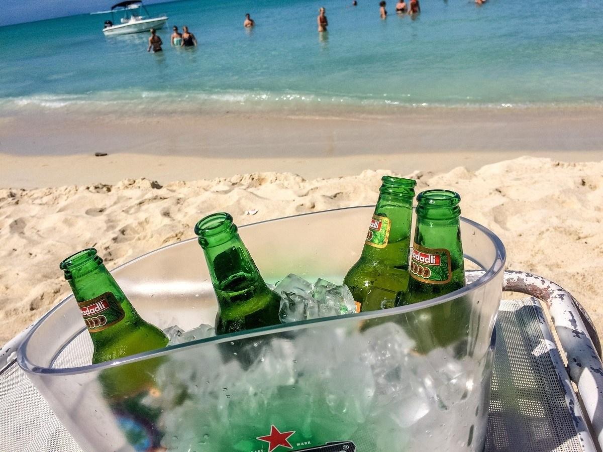 A bucket of Wadadli beer on the beach