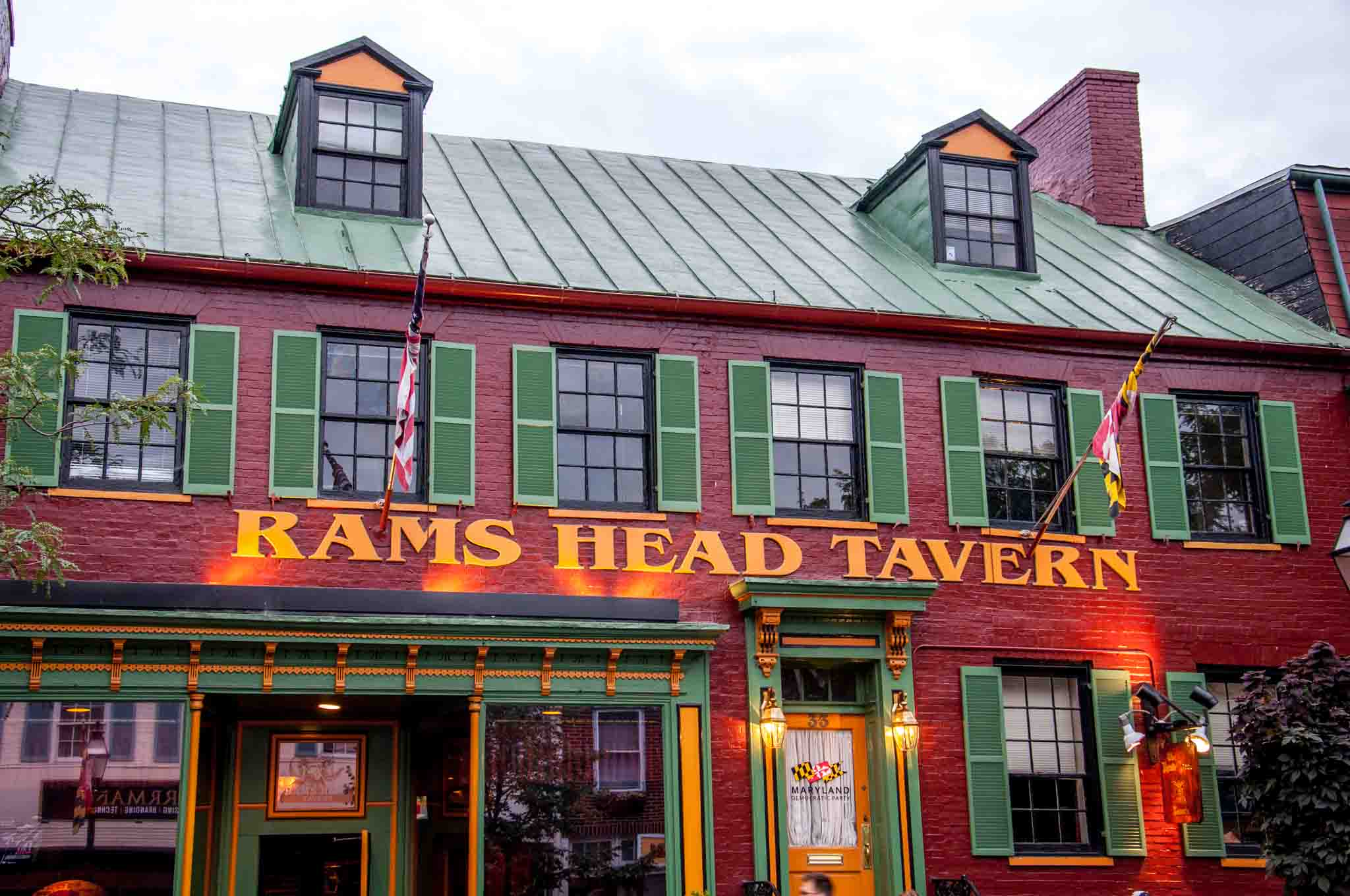 Painted red brick exterior of Rams Head Tavern