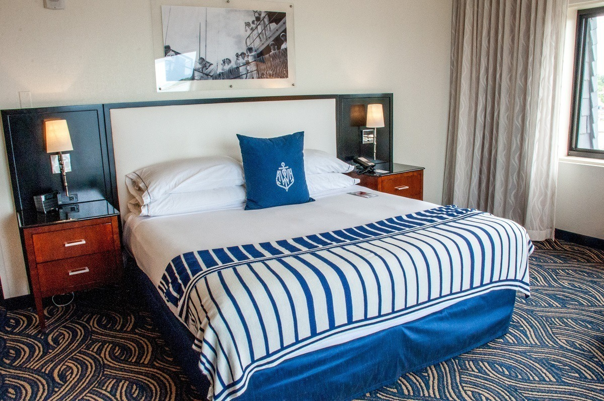 """Bed in the bedroom in the """"nautical chique"""" style at the hotel"""