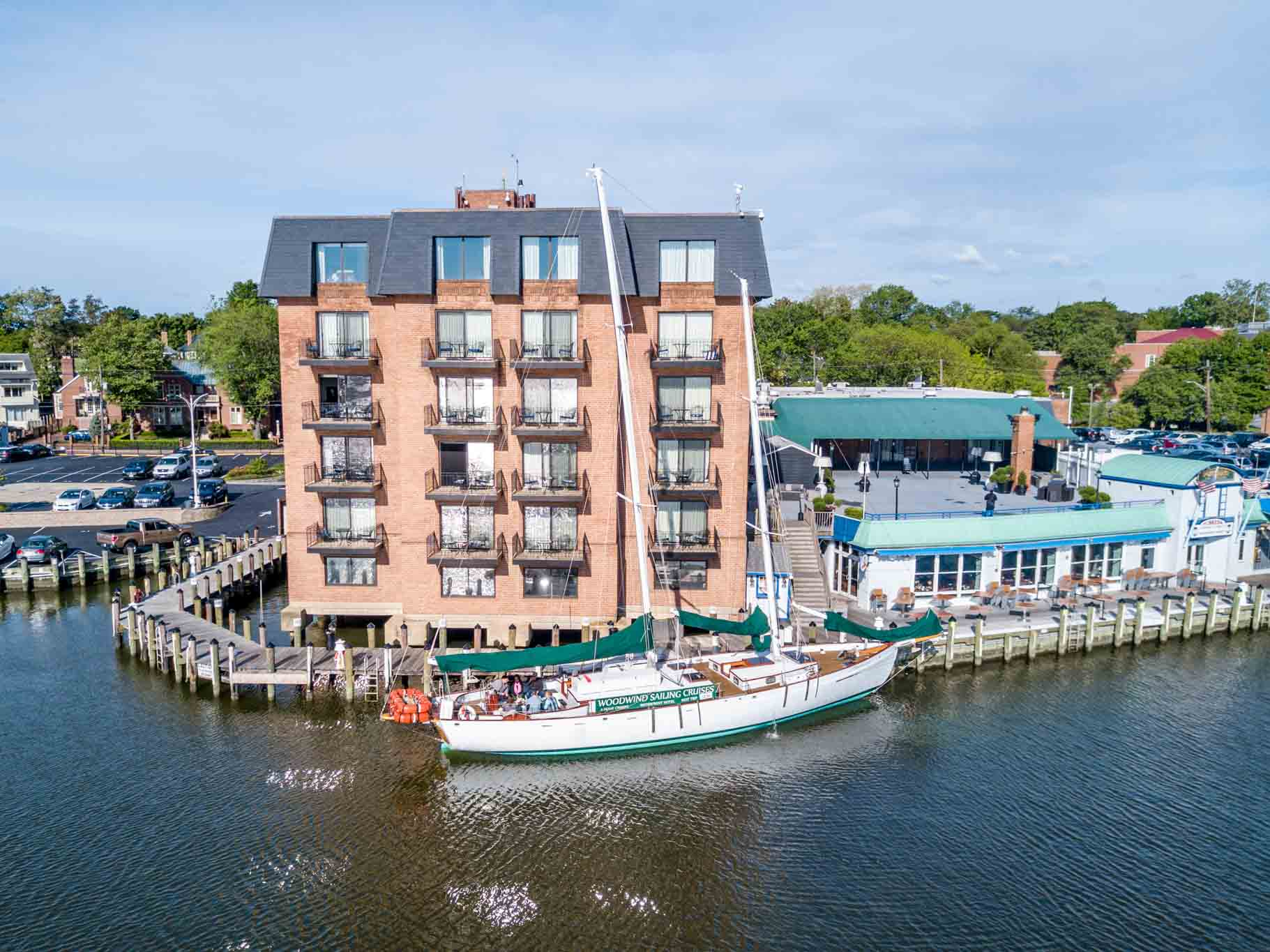 Aerial photo of the Schooner Woodwind in front of the Annapolis Waterfront Hotel