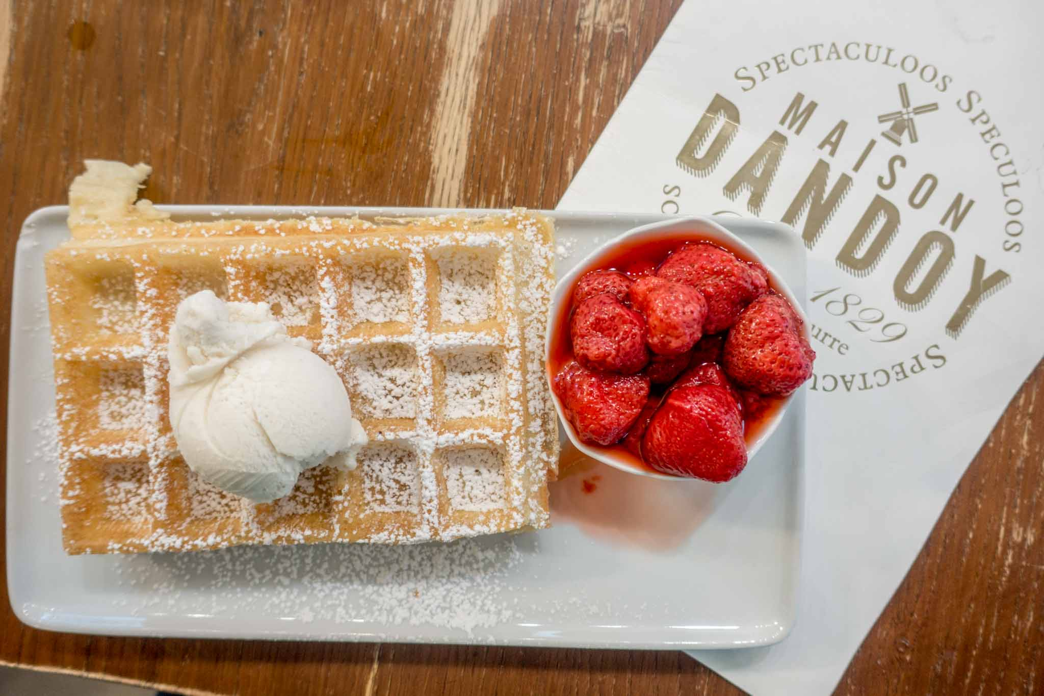 Waffle with ice cream and strawberries at Maison Dandoy