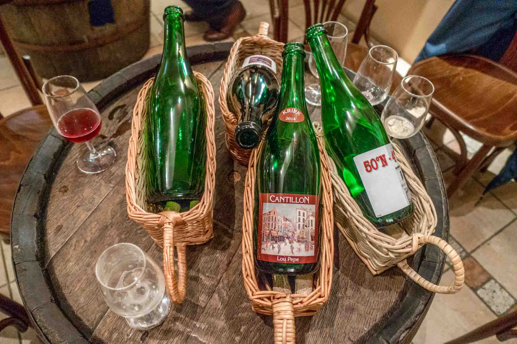 Beer bottles and glasses at Cantillon Brewery