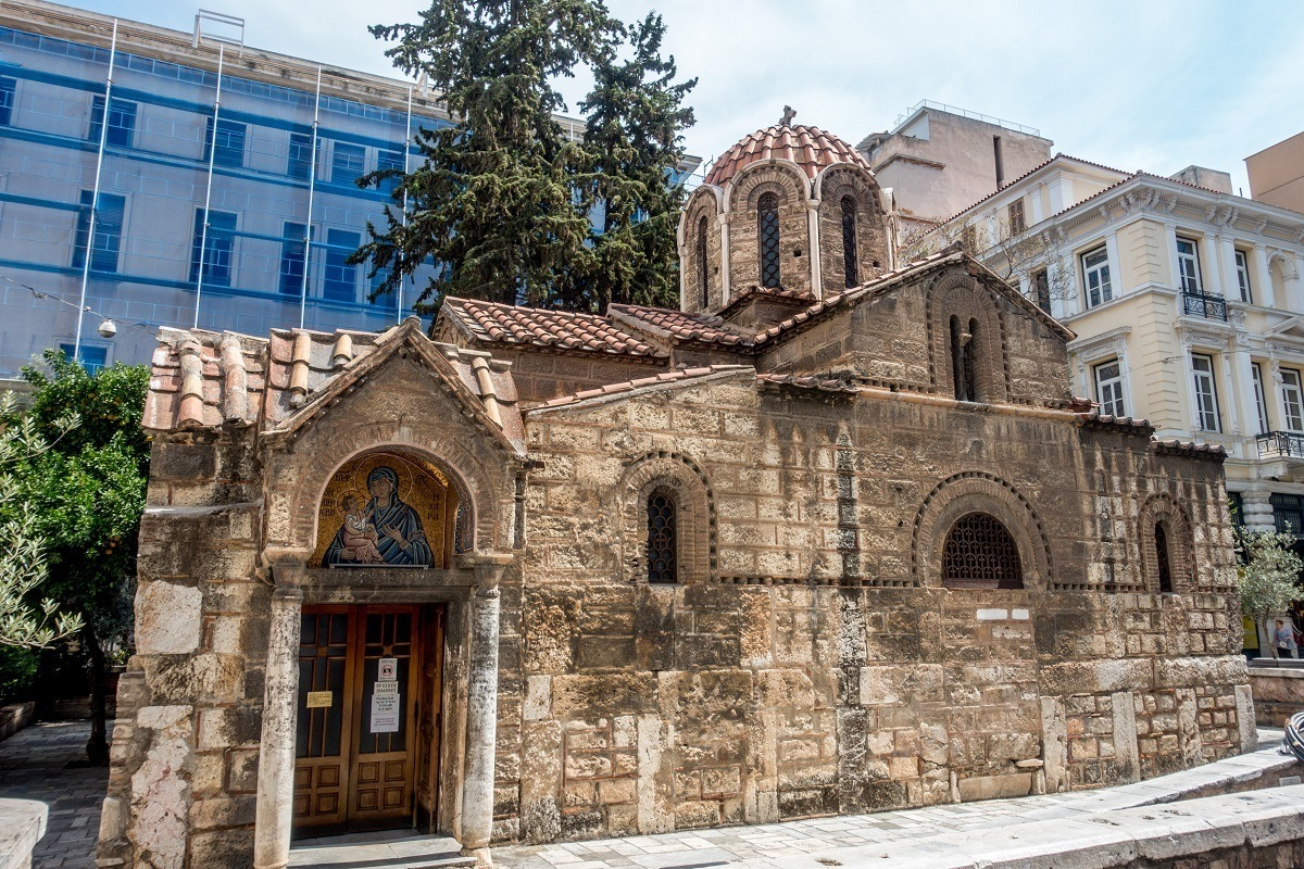 Small Church of Panagia Kapnikarea surrounded by modern buildings