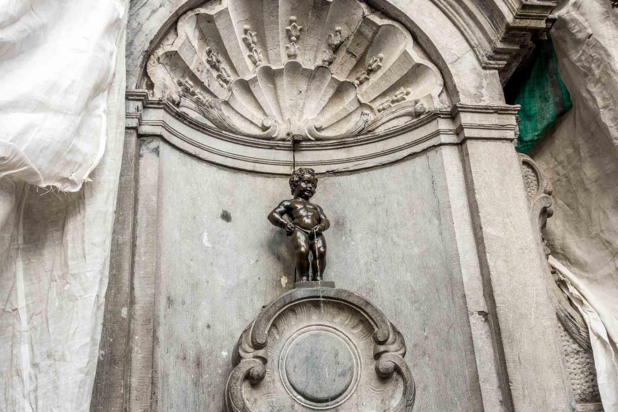 Statue of a little boy peeing
