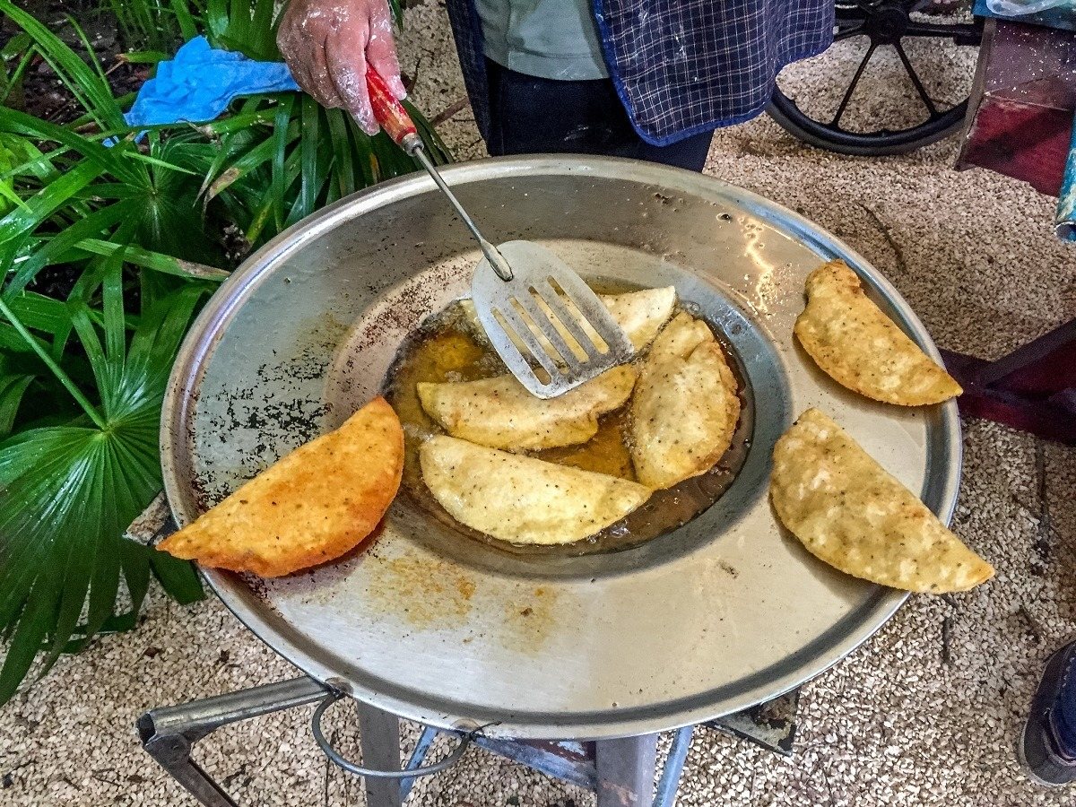 Molotes frying in pan