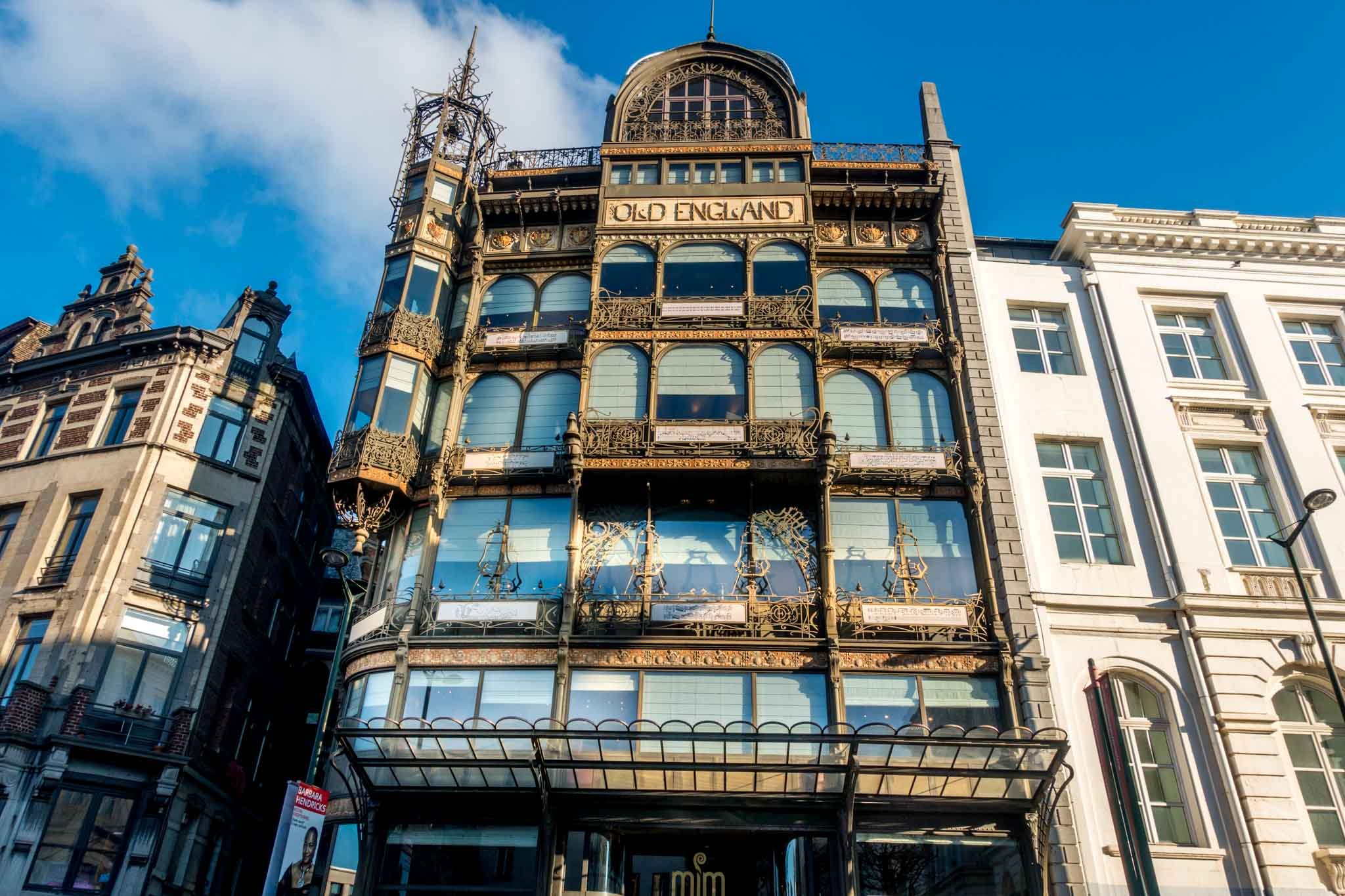 """Building with intricate wrought iron around the windows and """"Old England"""" sign"""