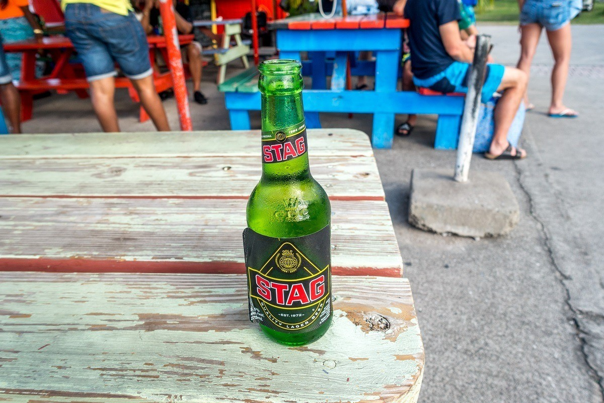 Bottle of Stag Beer in St. Kitts on a picnic table