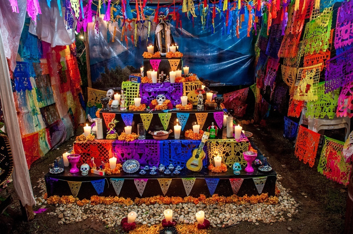Colorful altar with candles and memorial items