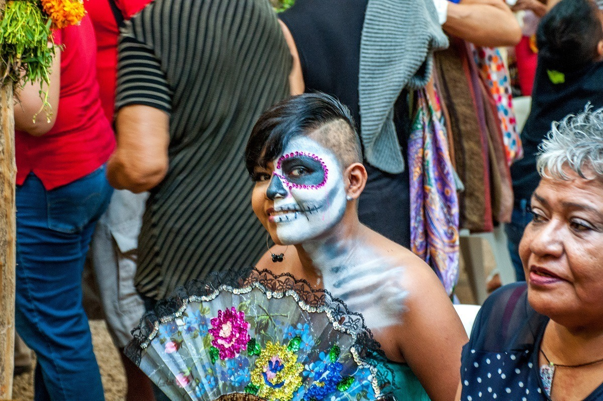 Woman with face paint for Day of the Dead holiday