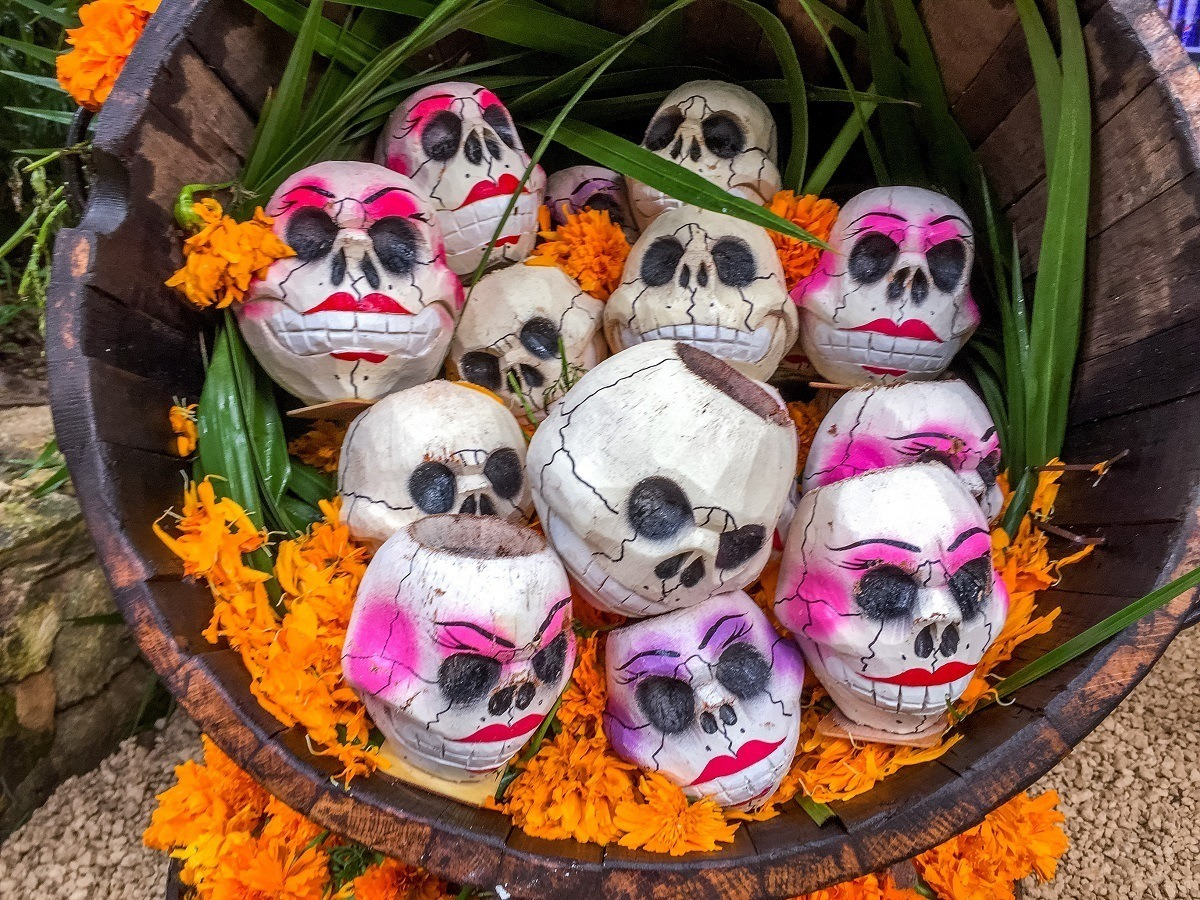 Painted wooden skulls on display at Xcaret for Day of the Dead