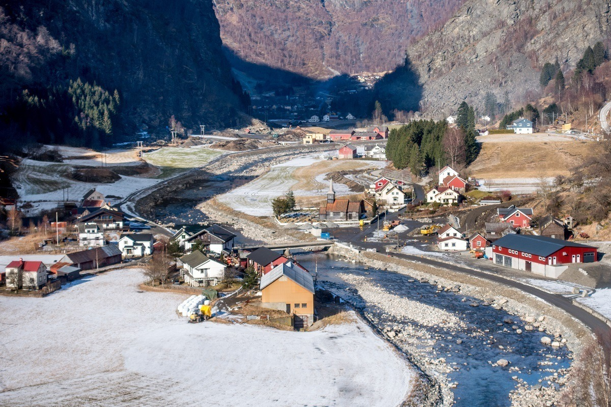 Colorful houses along a river snaking through a valley