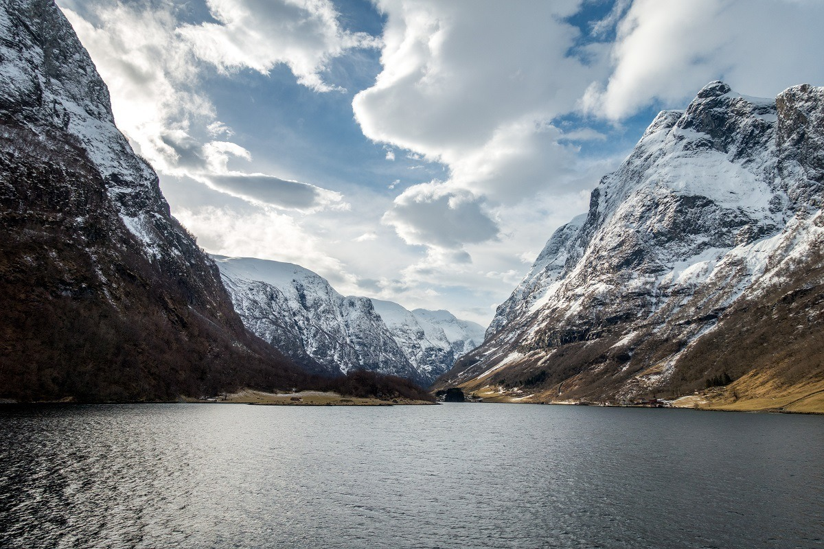 Water and snowy mountains of a fjord