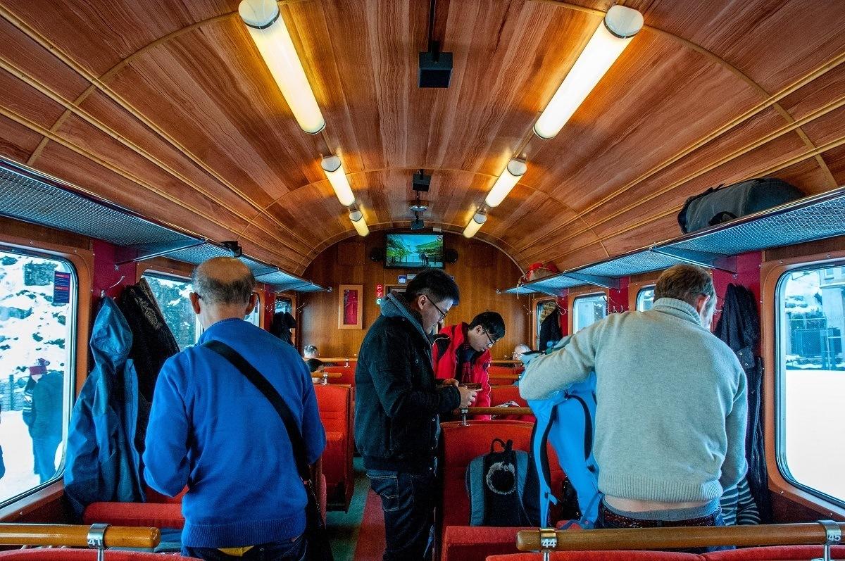 People boarding a railway car