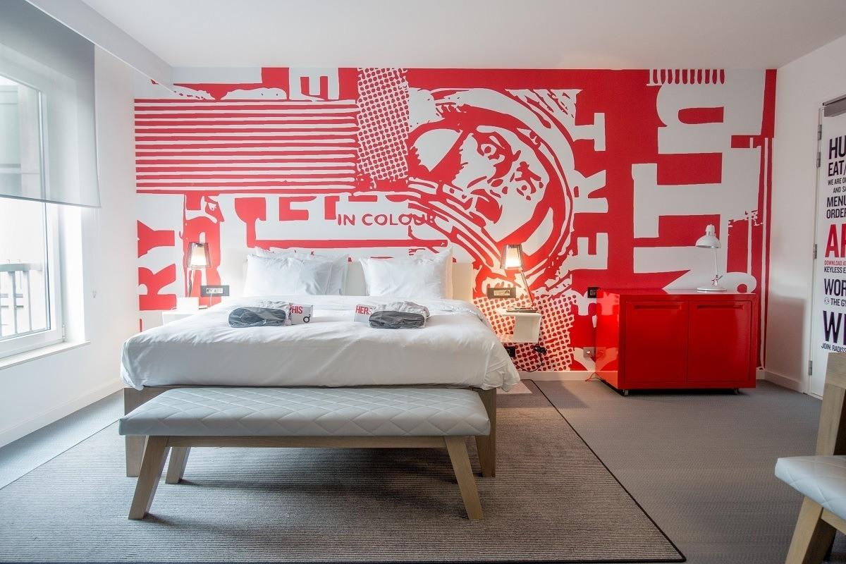 Hotel bedroom covered in cartoon artwork