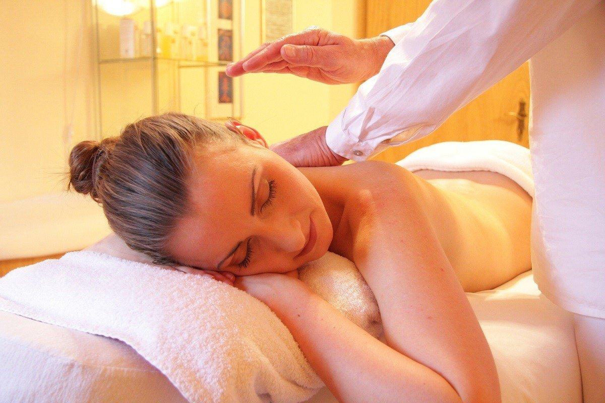 A woman receiving a massage treatment