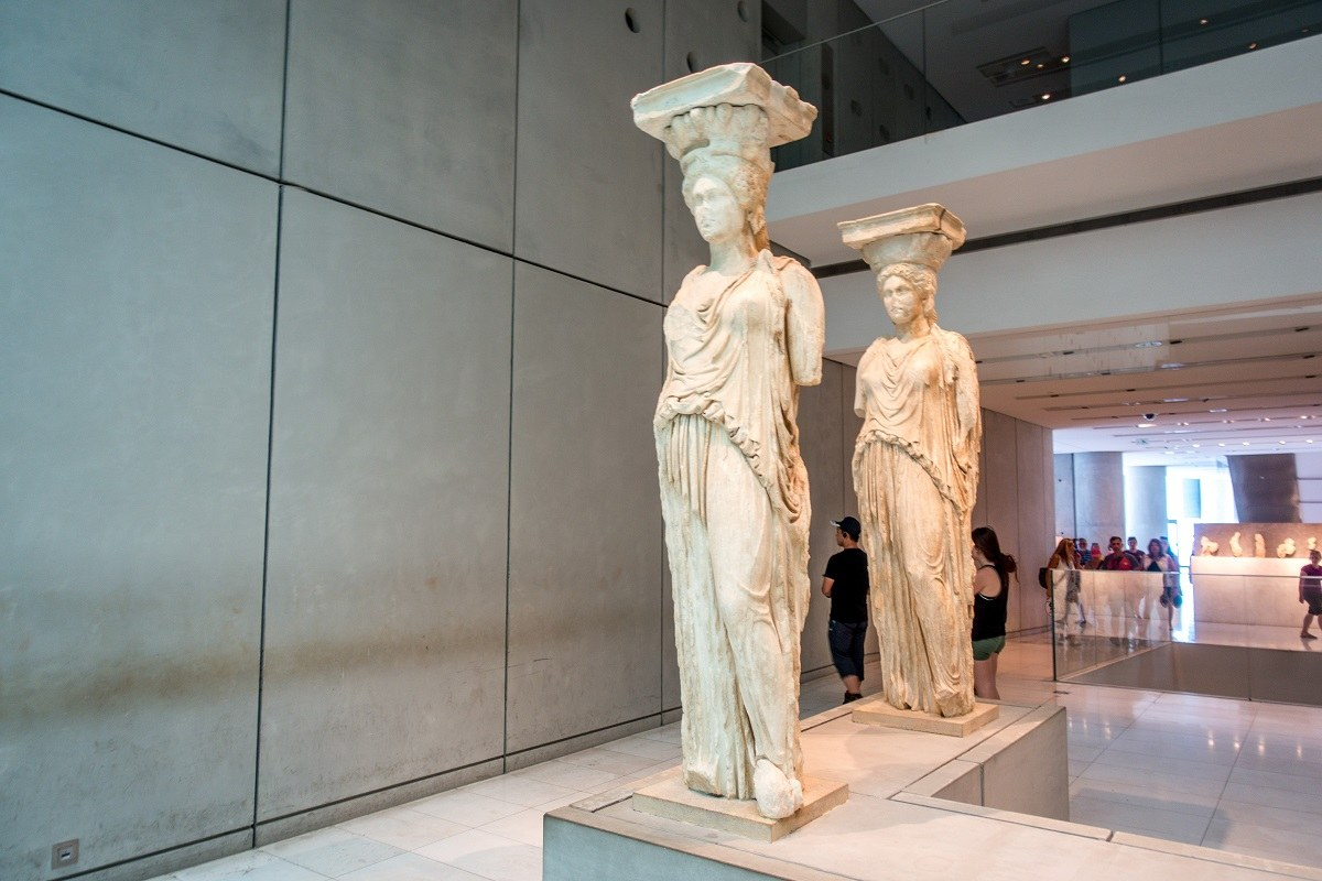 Marble statues of women displayed in a museum