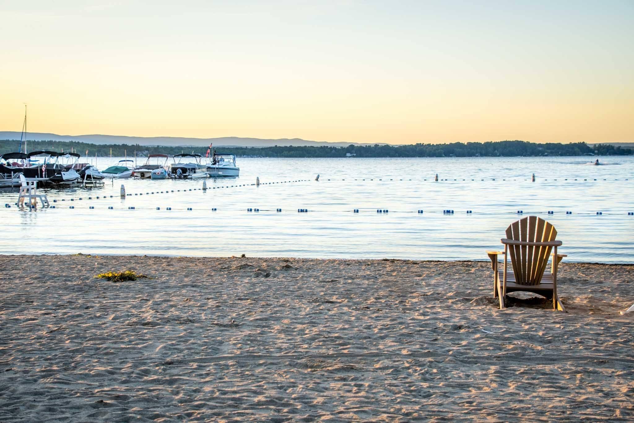 Adirondak chair on a beach by the water