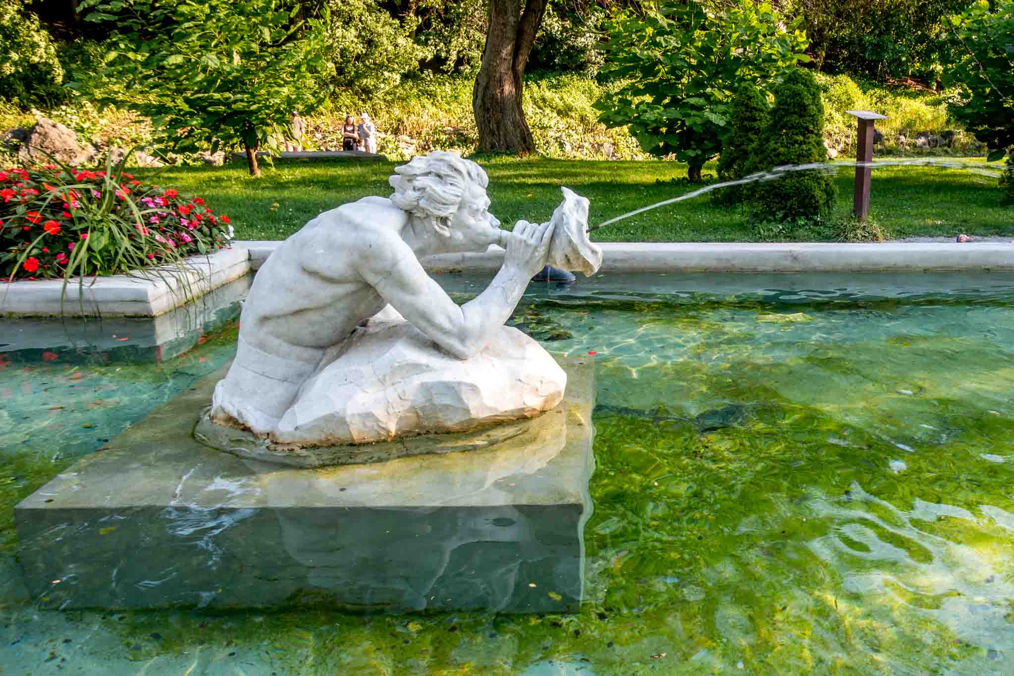Mermen fountain spouting water