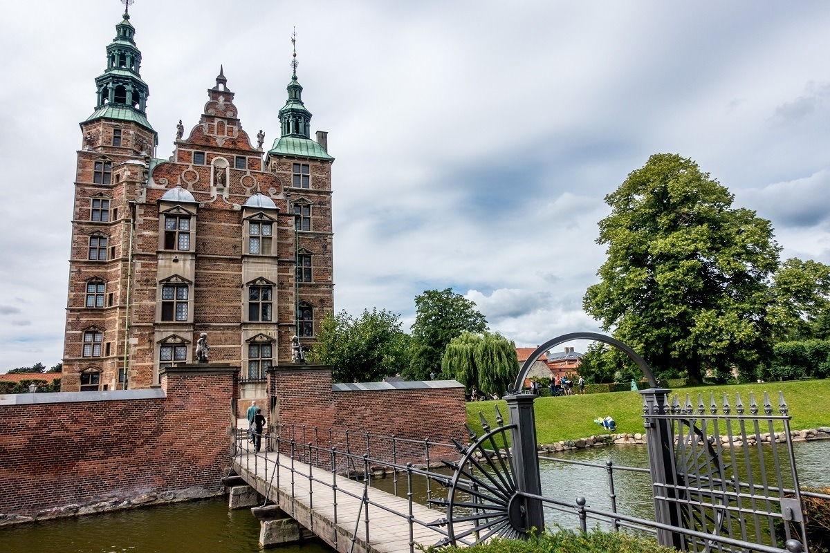 Bridge over a moat in front of a castle with two towers