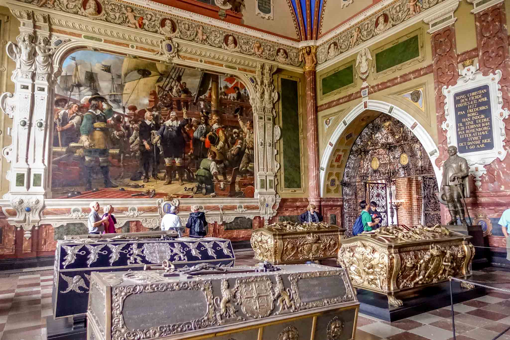 Decorated tombs inside a room with marble and paintings