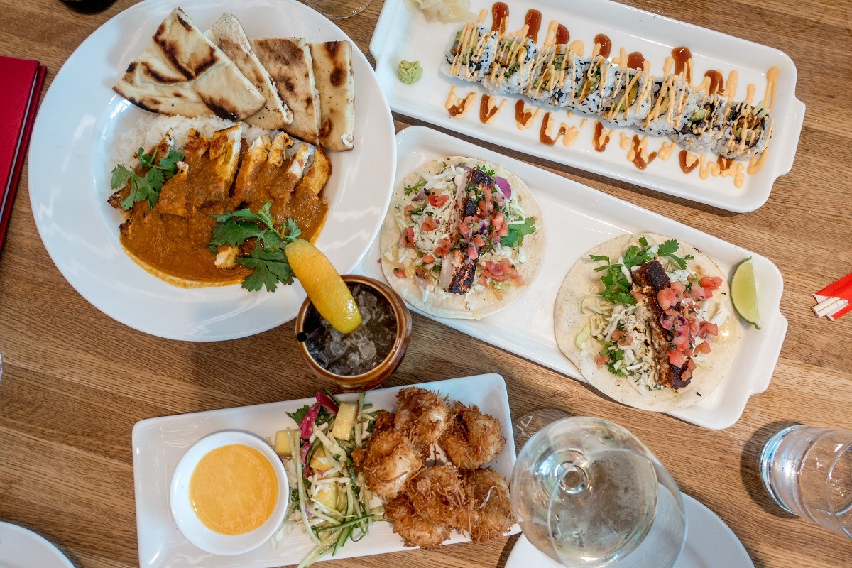 Sushi, tacos, and other food on table