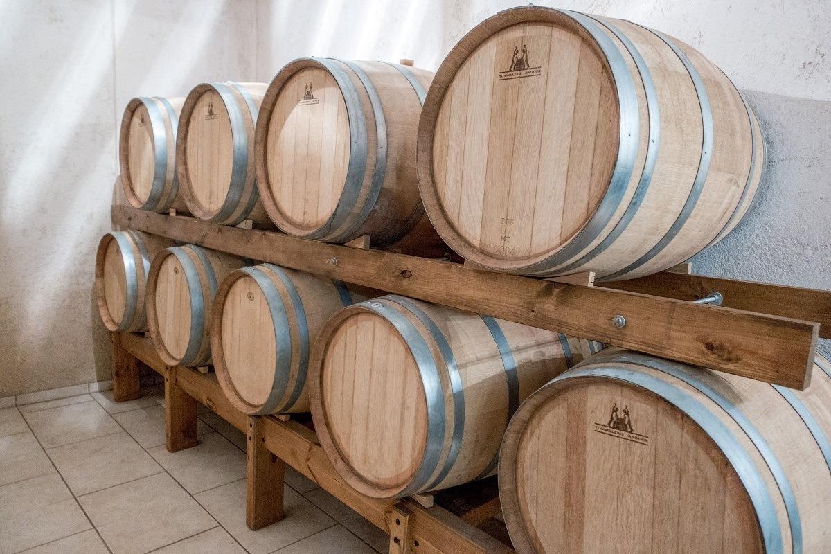 Wine aging in barrels at Stilianou winery in Crete