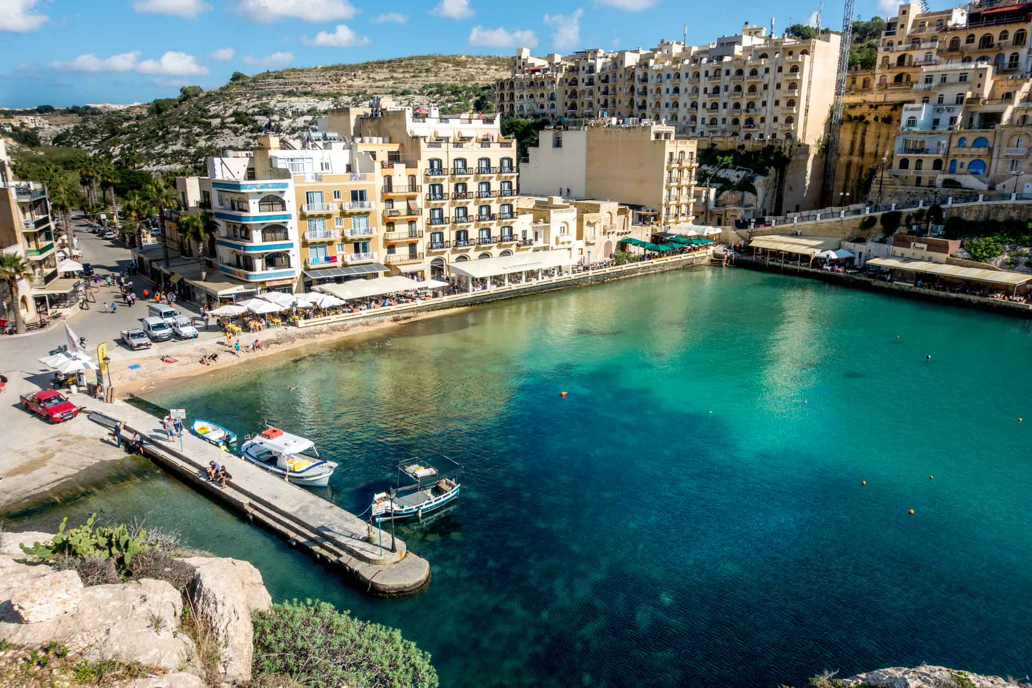 Bay surrounded by buildings in Xlendi, Malta
