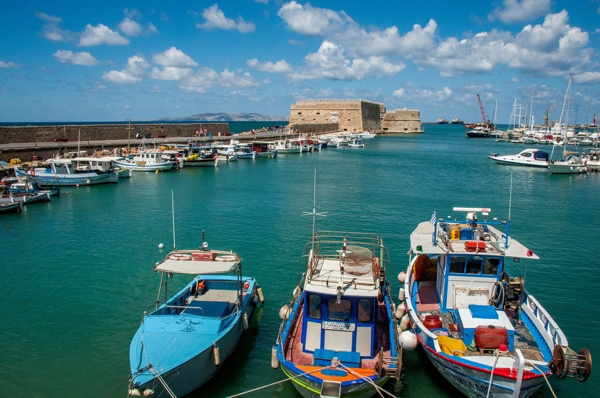 Boats and stone fort in the Port of Heraklion in Crete, Greece