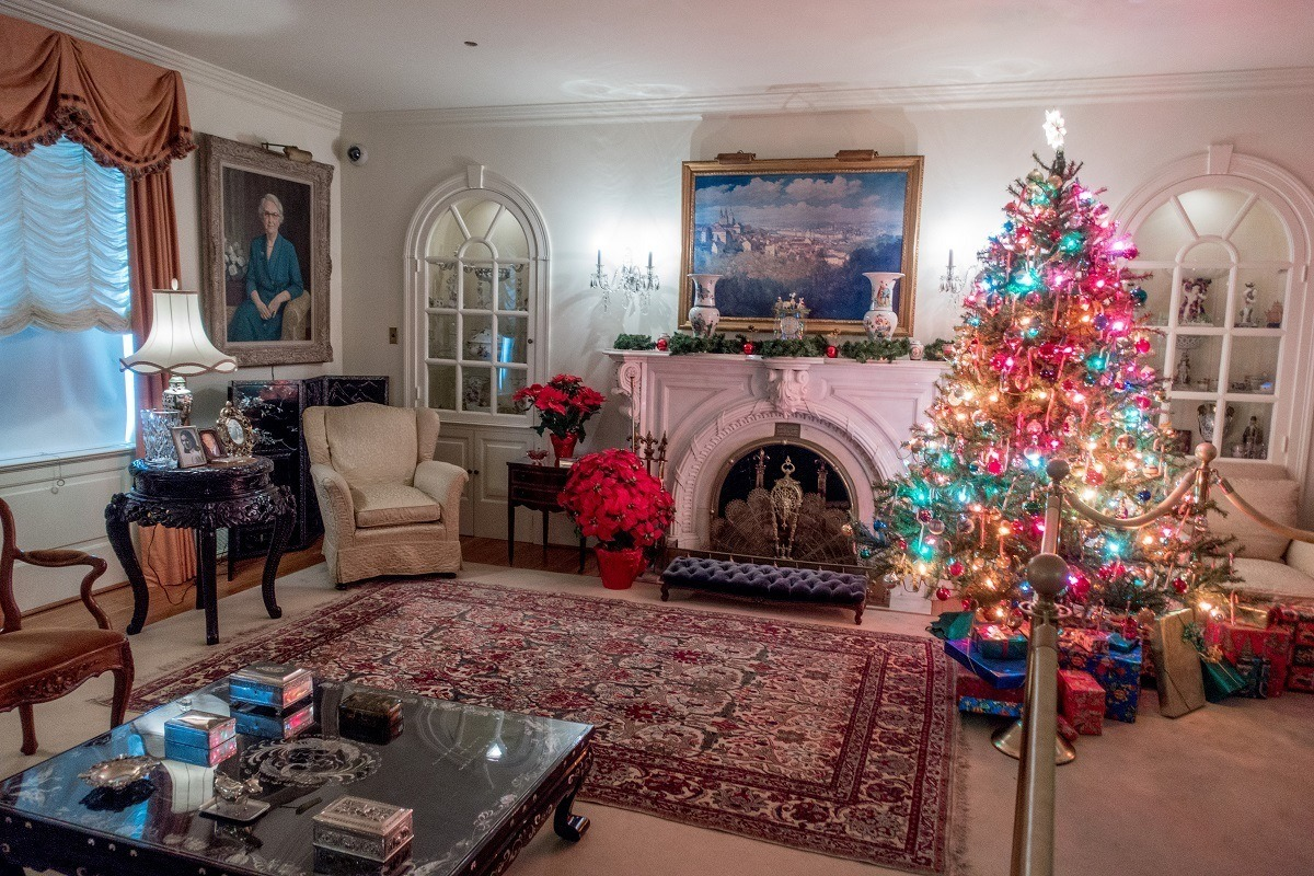 Christmas tree and presents in the living room of an historic home
