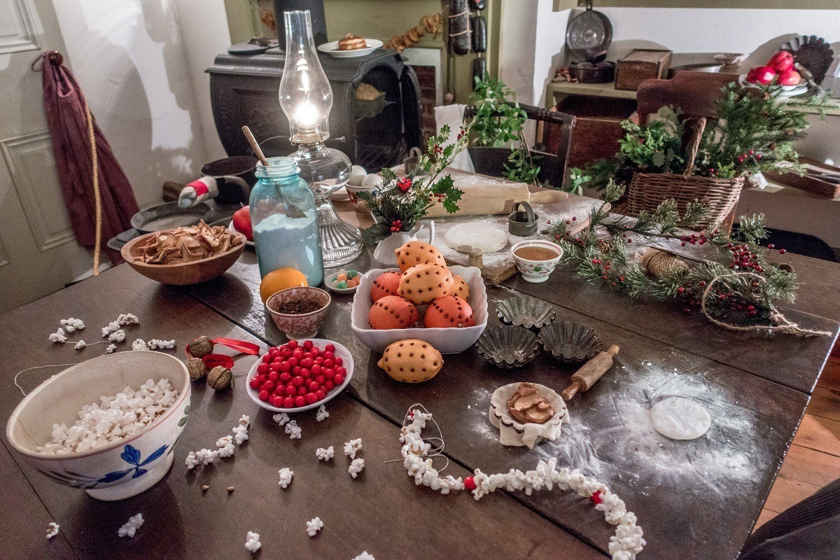 Old-fashioned Christmas decorations and holly on a table