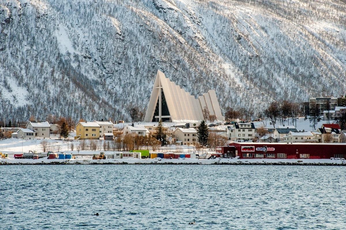 White, triangle-shaped church near the ocean