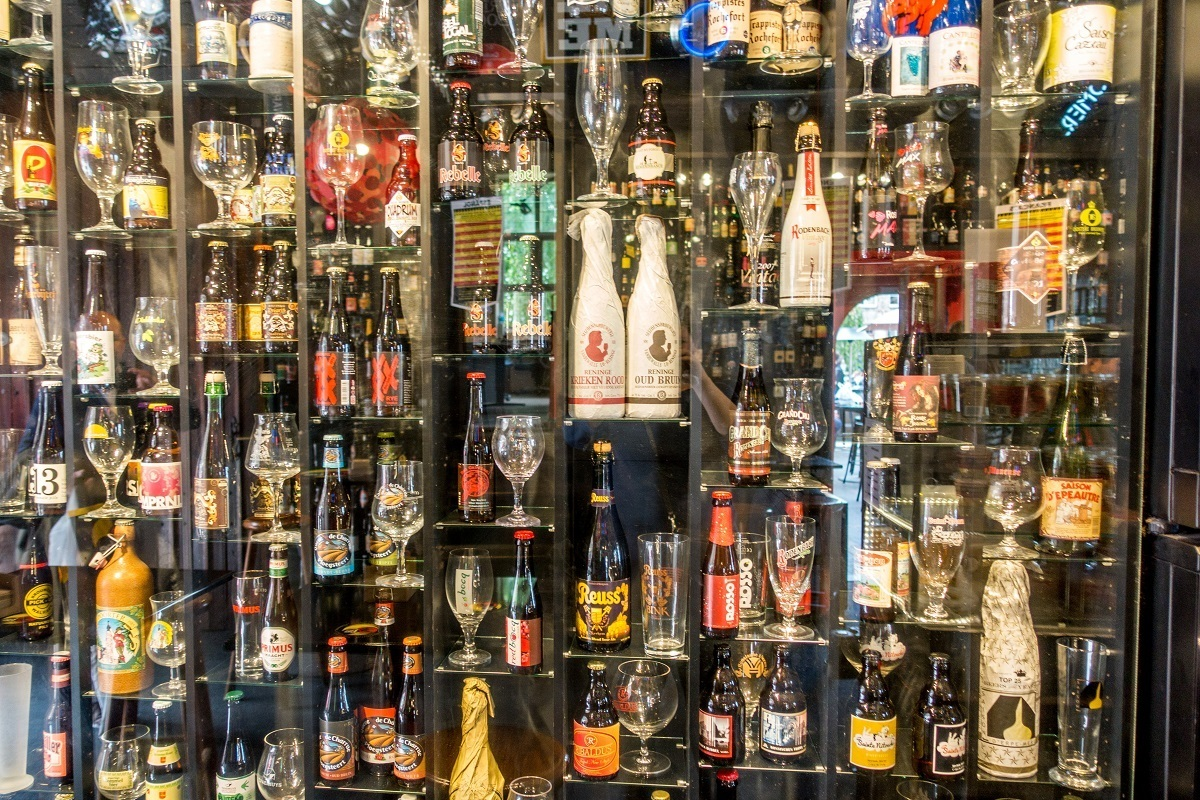 Wall of beer bottles and glasses