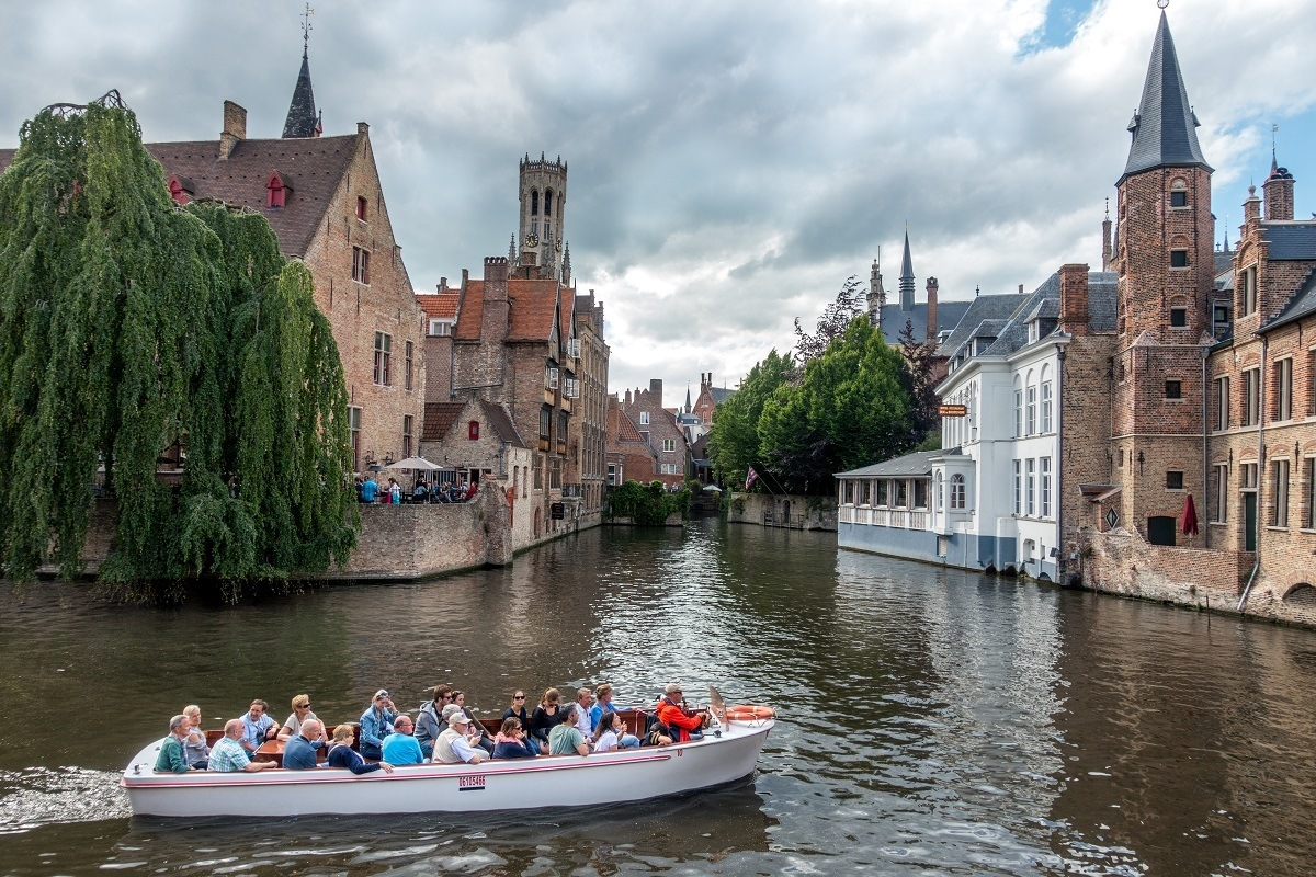 Boat cruising between two buildings
