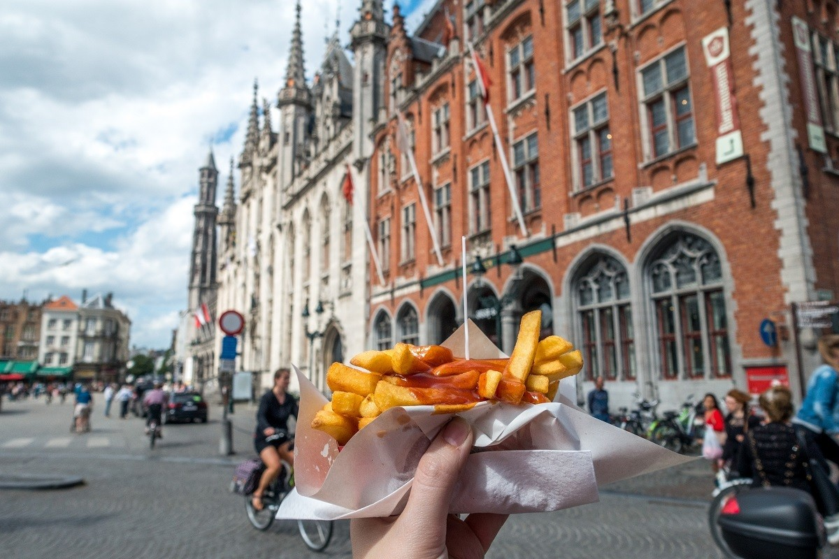 French fries in front of a building in Bruges market square
