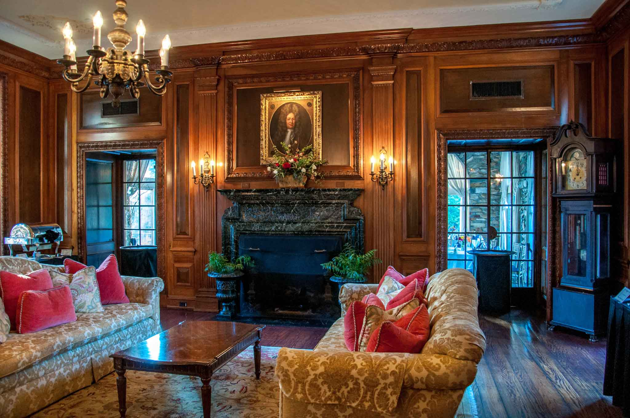 Room with brocade couches and marble fireplace at Graylyn Estate