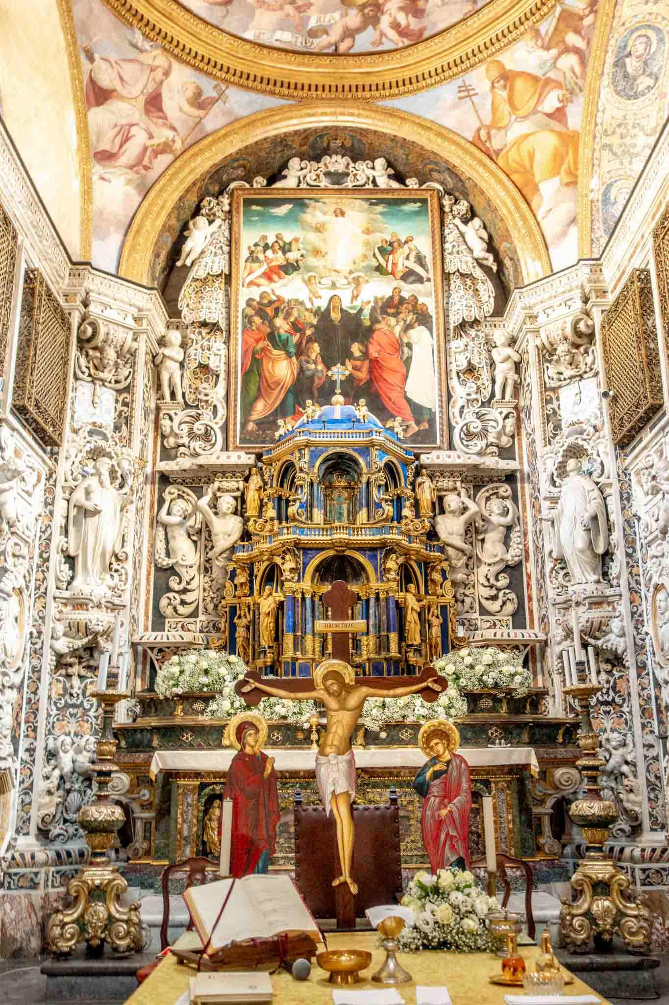 Elaborate carved marble altar with a painting of Jesus