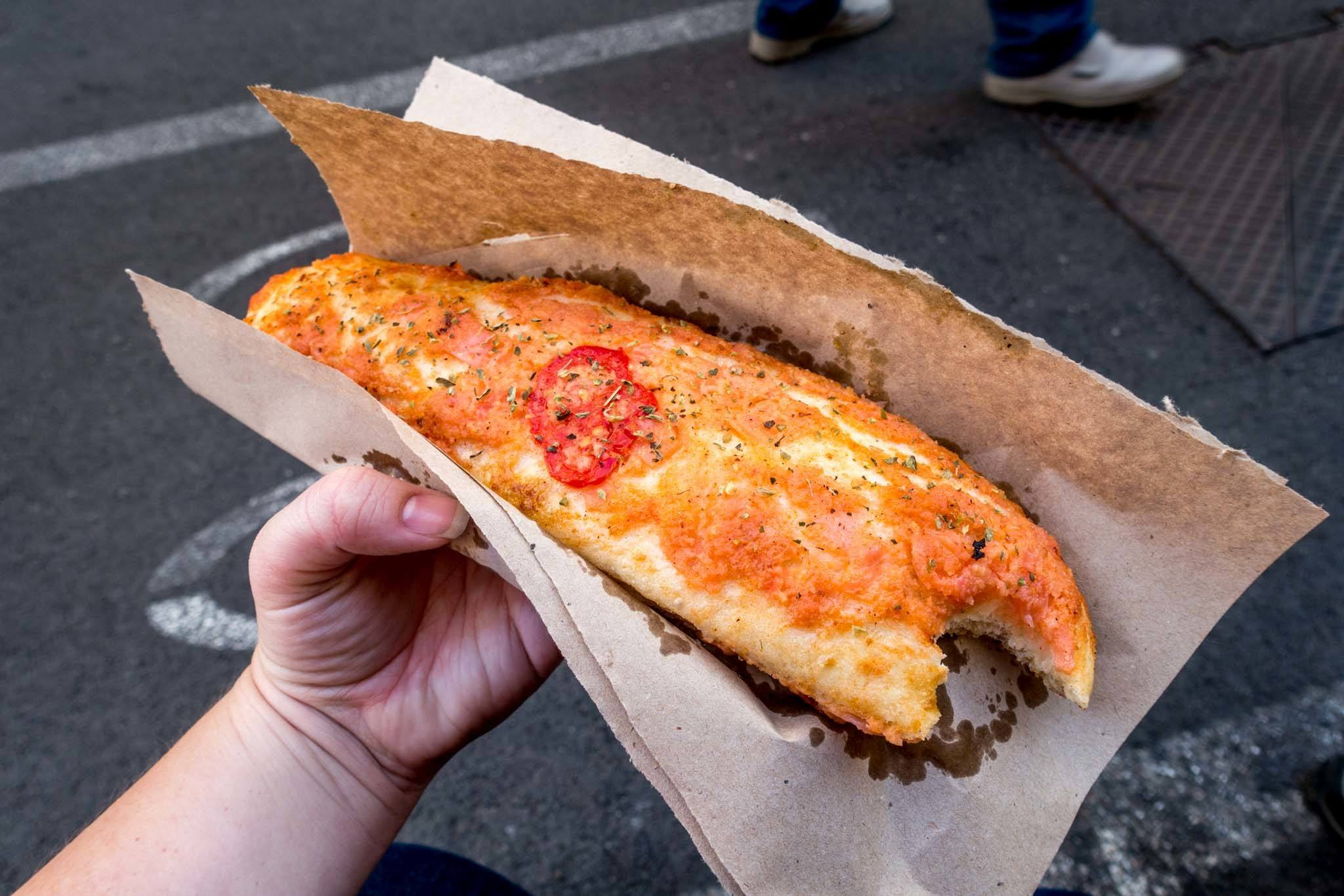 Bread covered in melted cheese and tomato sauce