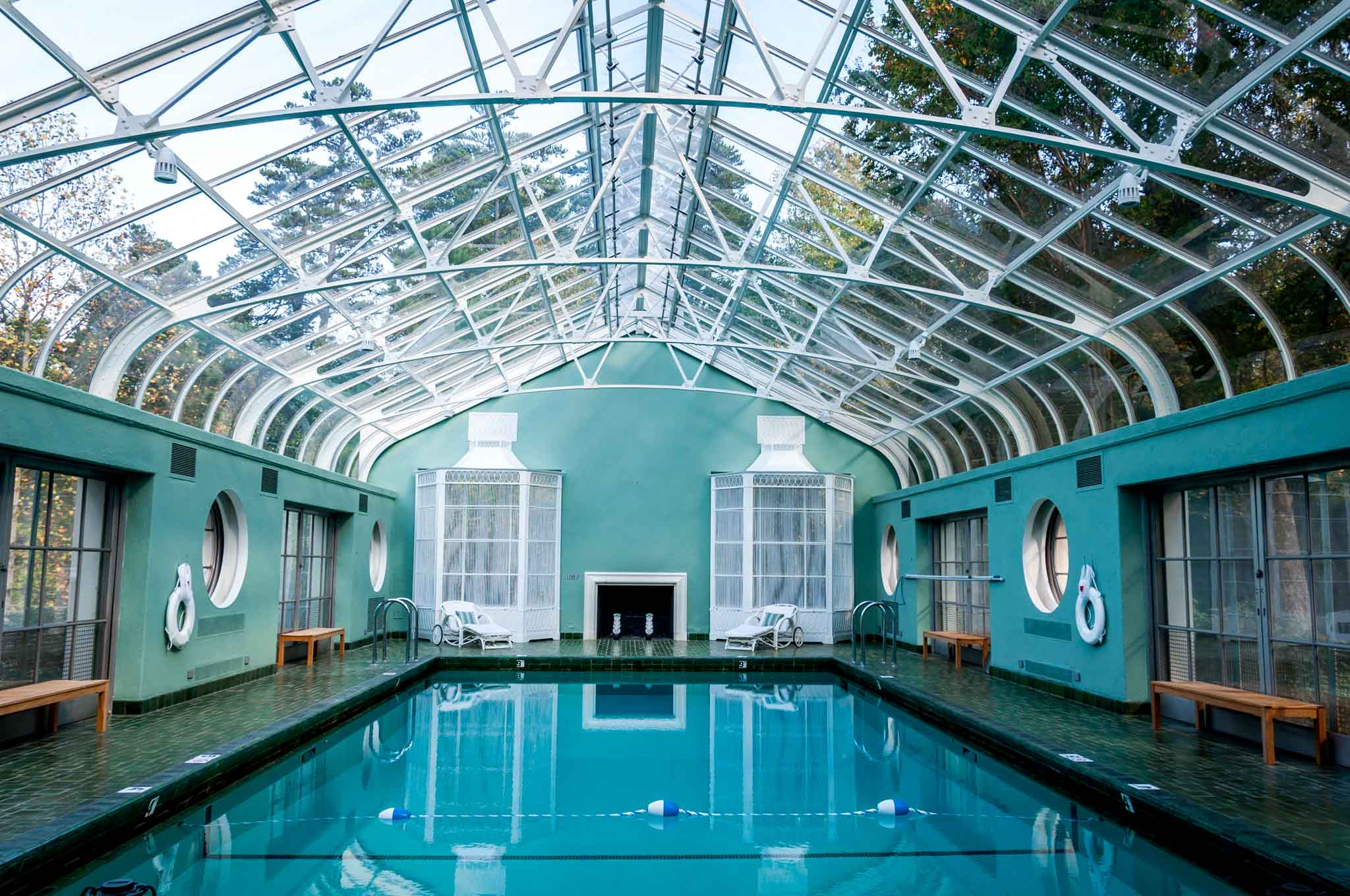 Indoor pool in room with a glass ceiling