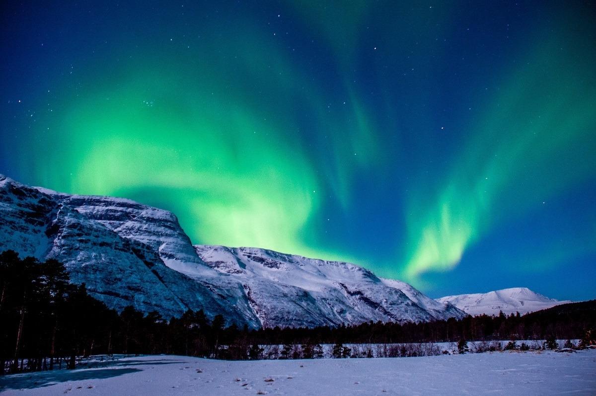 Northern Lights above a snowy landscape