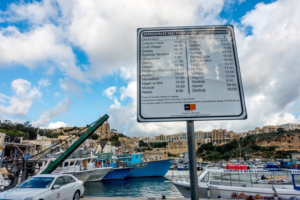 Sign with taxi rates
