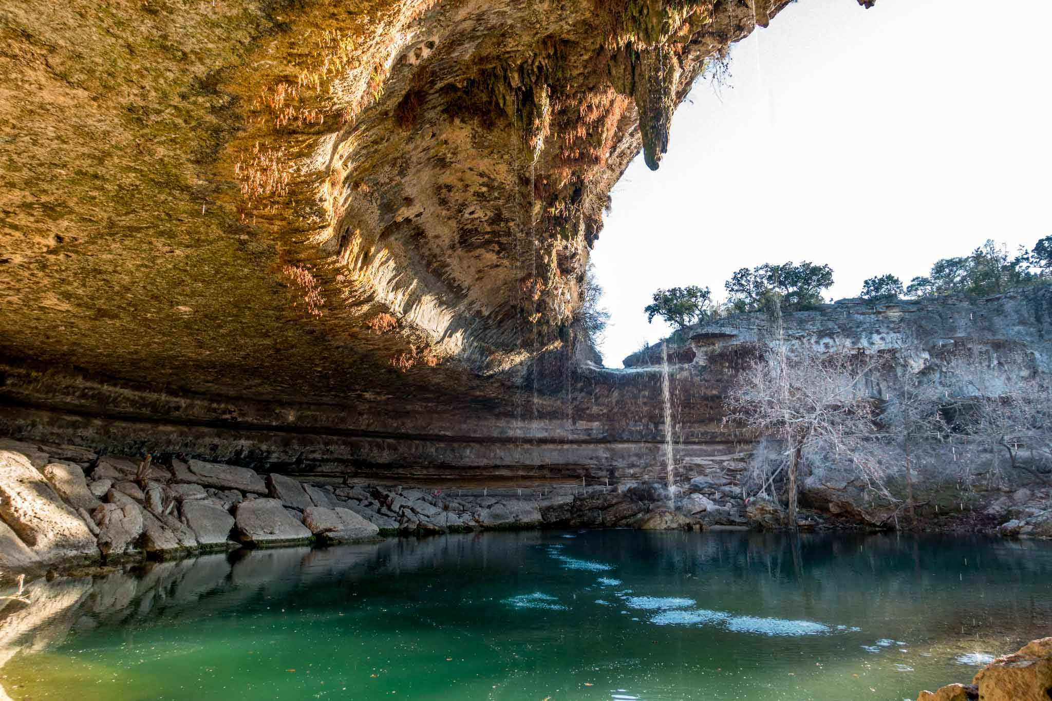 Water dripping into a large natural pool
