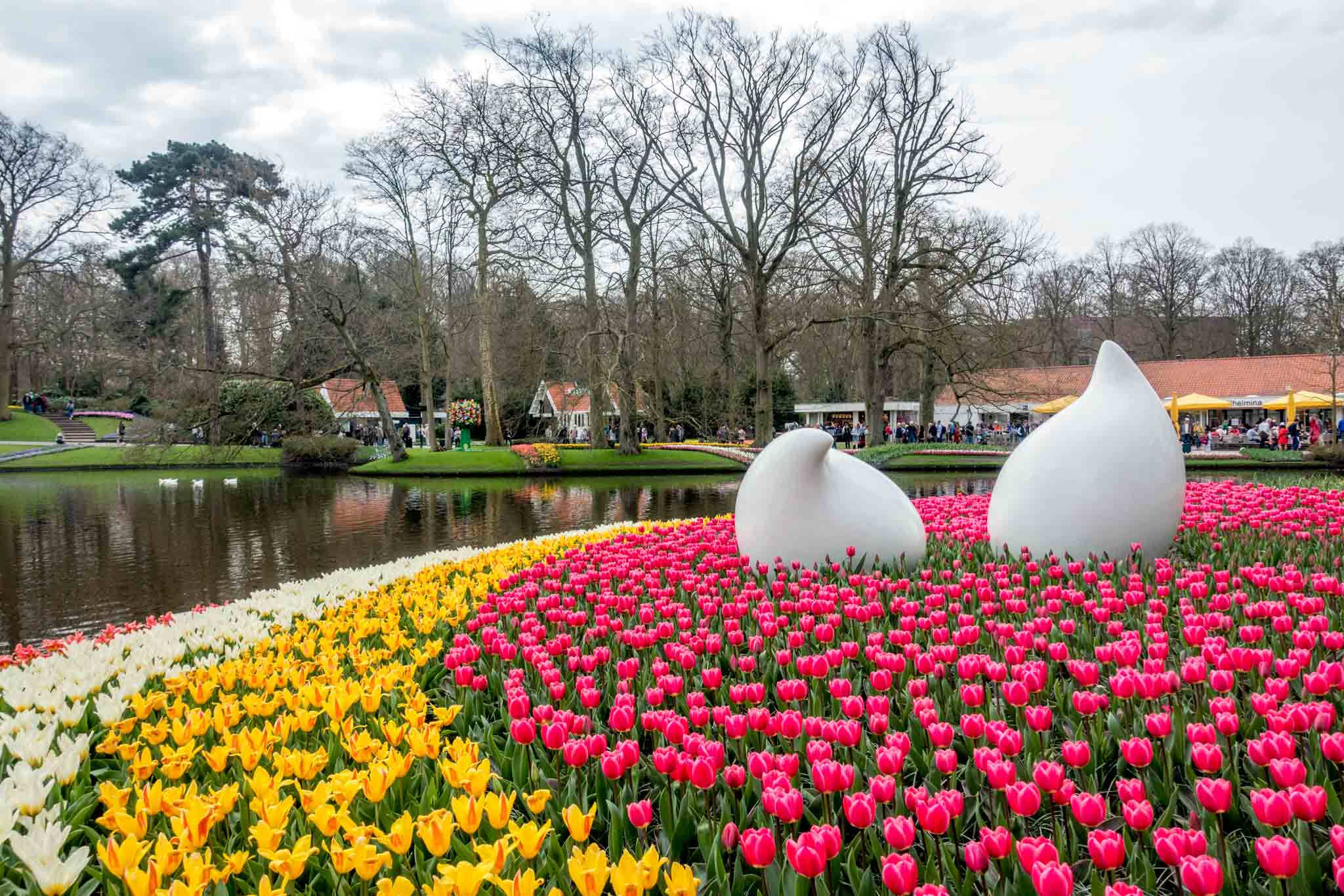 Sculpture surrounded by tulips