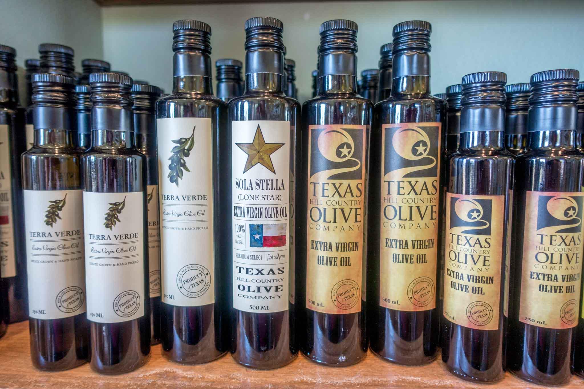 Bottles of olive oil on shelf
