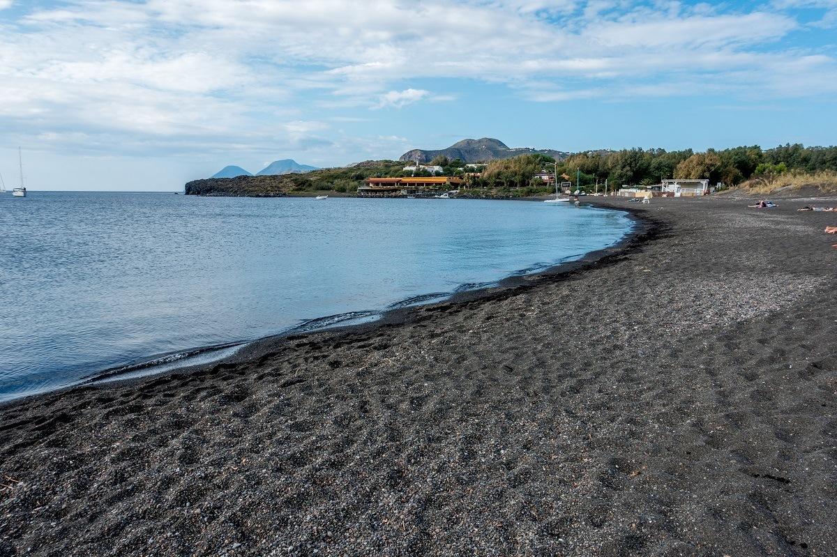 Relax at Porto di Ponente on the Spiaggia Sabbia Nera, a black sand beach