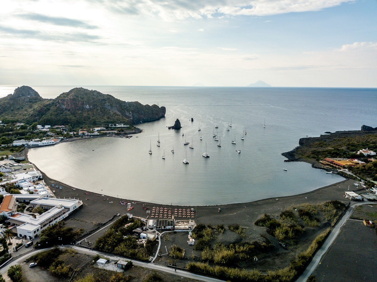 Sailboats in a small bay with black sand beach on Vulcano Island