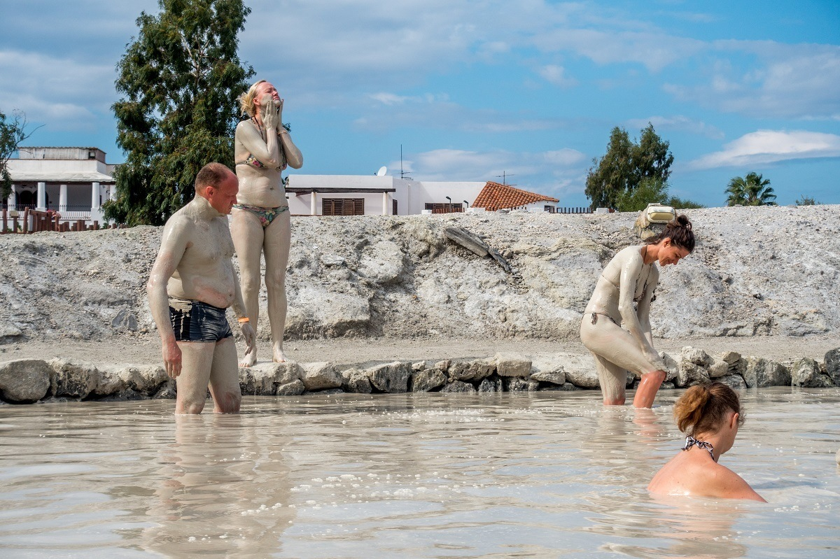People slathering their bodies in mud and silt at the Vulcano mud baths