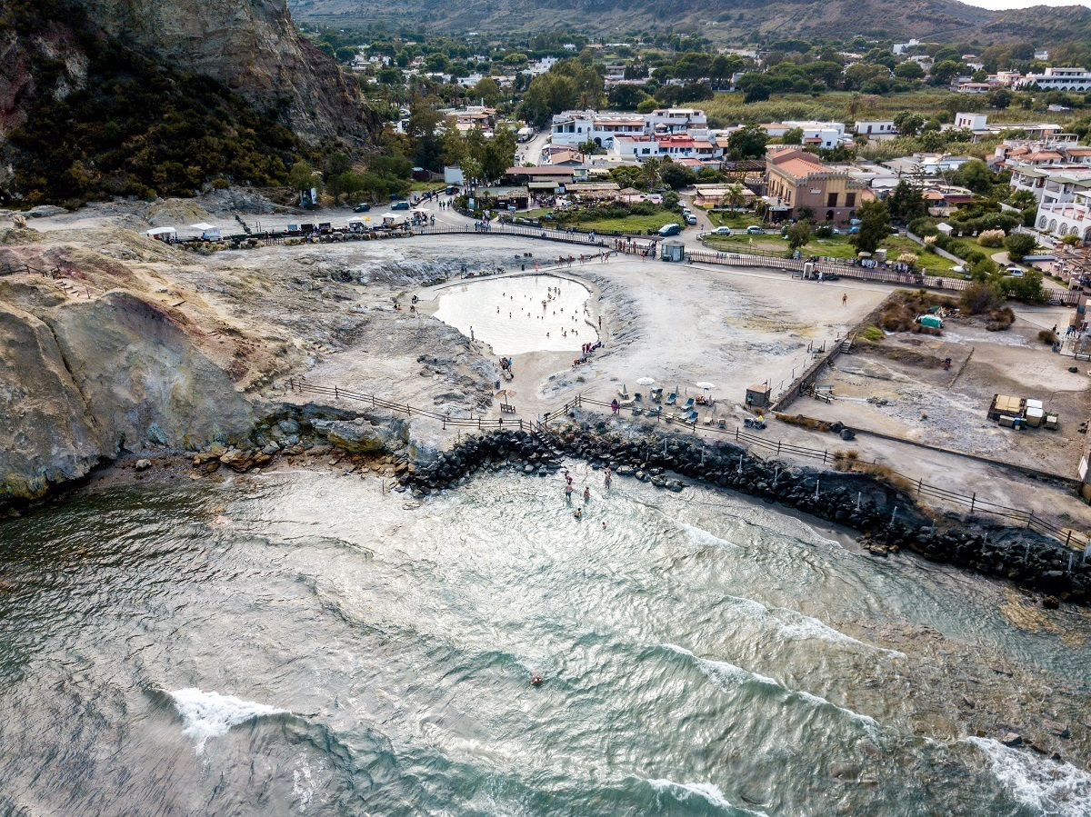 Aerial photo of the baths and people getting into the ocean